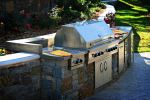A grill built into a Tulsa outdoor kitchen